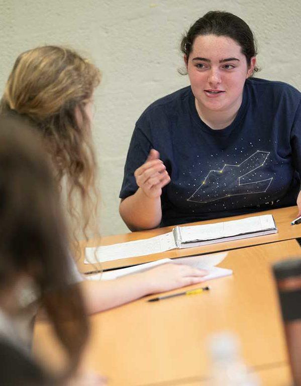 Students talking at a table